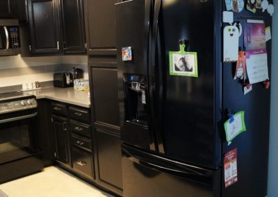 Snow's Painting painting cabinets black
